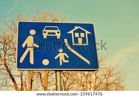Traffic sign for playground area against the sky - stock photo