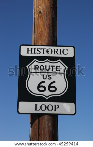 Traffic sign on the American highway, on a wooden column. Historic route 66 - stock photo