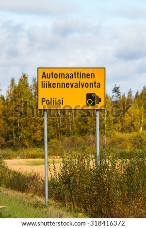 Traffic sign on the road in Finland, which tells the automatic speed control. - stock photo