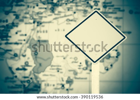 traffic sign post with blur part of world map background - stock photo
