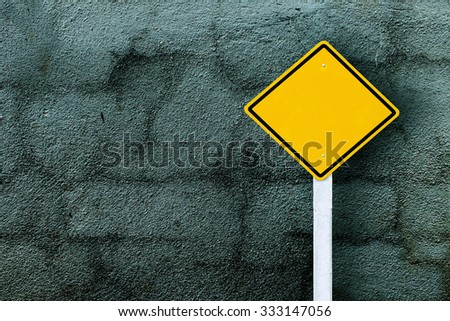 traffic sign post with dark crack wall background ,vintage tone - stock photo