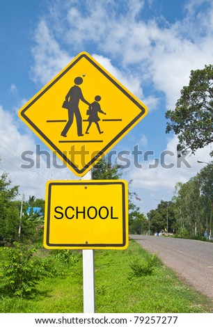 Traffic sign (School warning sign) and blue sky. - stock photo