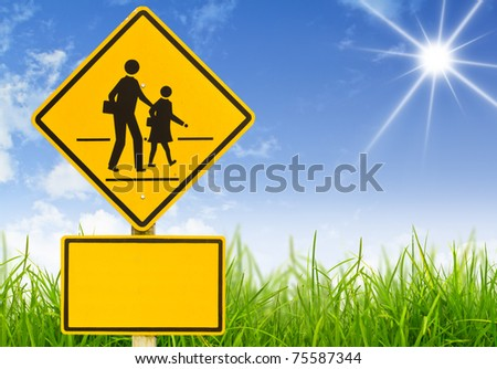 Traffic sign (School warning sign) on grass - stock photo