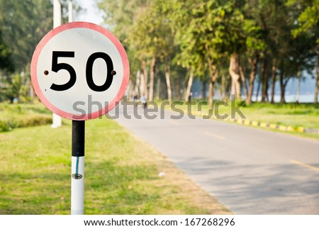 Traffic sign speed limit 50 miles per hour on the streets. - stock photo