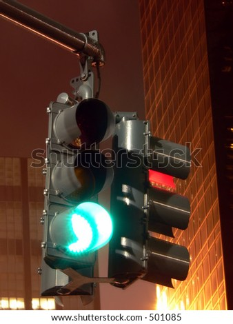 Traffic Signal at Night -- Stop and Go.  Red and Green lights on a signal - stock photo