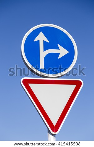 traffic signal caution and red and blue triangle and circle obligation - stock photo