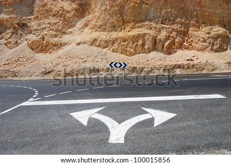 Traffic Signal,road signs arrows on asphalted surface - stock photo