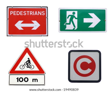 Traffic signs for pedestrians, bike, congestion charging, fire exit - stock photo