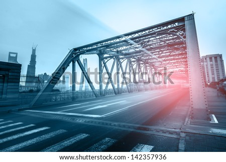 traffic through bridge with blur trail - stock photo