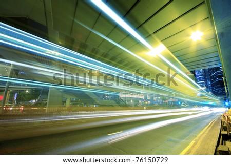 traffic through downtown in hong kong at night - stock photo