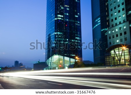 Traffic through downtown  the lujiazui financial centre in shanghai china. - stock photo