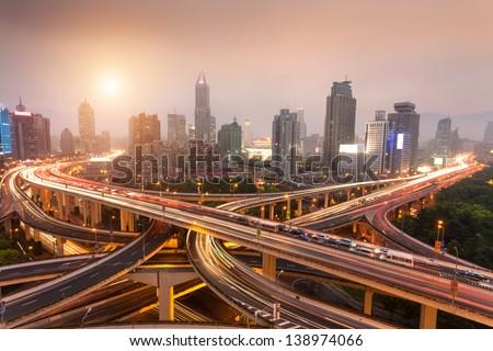 traffic through modern city - stock photo