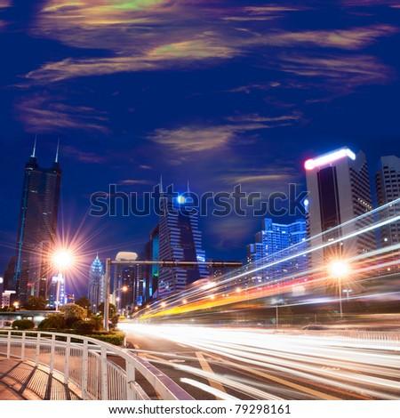 Traffic through the modern city - stock photo