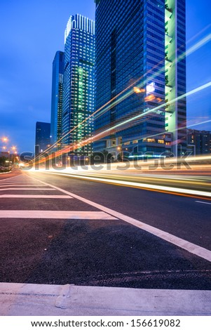 Traffic trails at twilight  on the  cityscape background in shanghai,China - stock photo