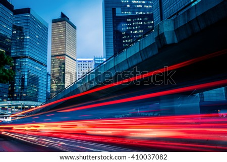 traffic trails in the downtown district,hongkong china. - stock photo