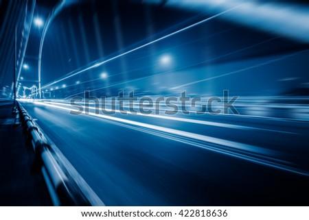 traffic trails on bridge,chongqing china,blue toned image. - stock photo