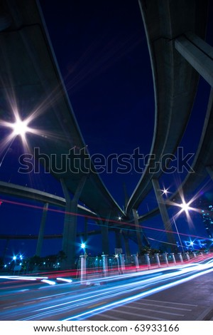 Traffic under the Bhumibol Bridge in Bangkok, Thailand. - stock photo