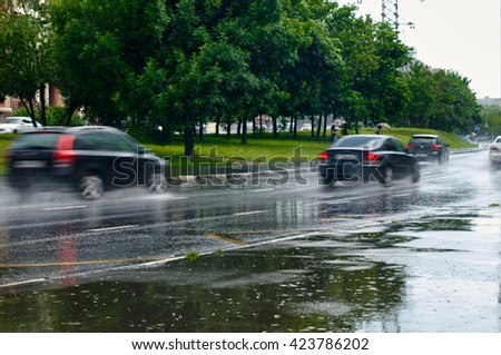 traffic under the rain - stock photo