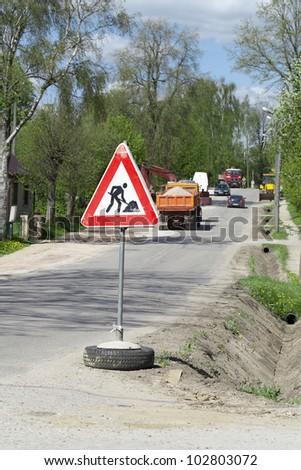 Traffic,warning sign road repairing - stock photo