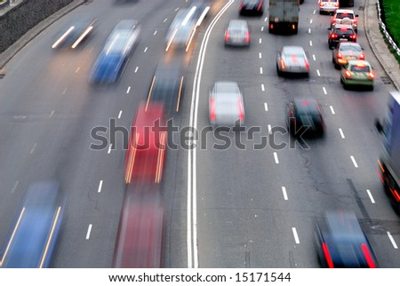 Traffic with motion blur (long exposure shot). - stock photo