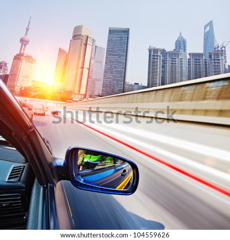traffice thourgh big city,shoot from brush car,very fast speed - stock photo