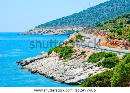 trail in the mountains near the sea - stock photo