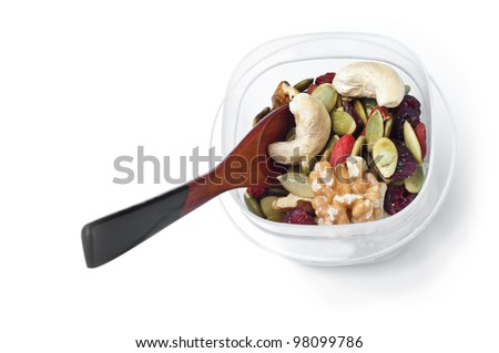 Trail mix container with spoon on white - stock photo