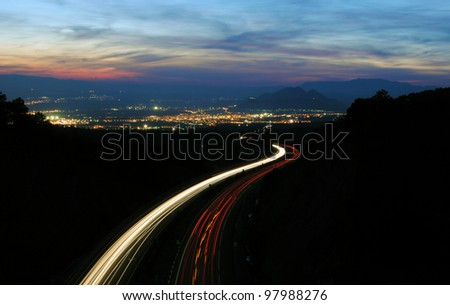 Trail of cars on the highway, Granada, Spain - stock photo
