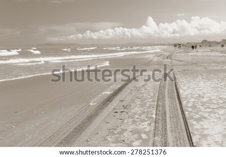 trail of tyres on the beach - stock photo