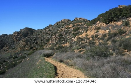 Trail on a hillside with sandstone geology, California - stock photo