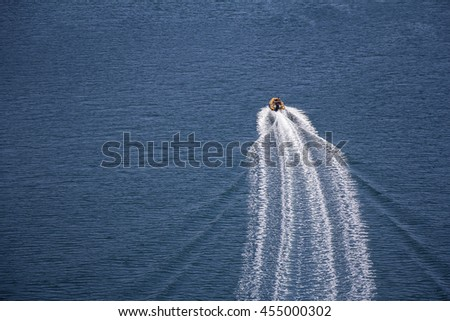 Trail on sea surface behind of speed boats - stock photo