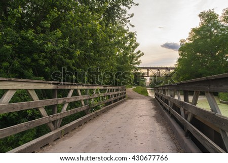 Trail on the tow path along the historic I & M Canal on a late Spring afternoon in LaSalle, Illinois, U.S.A.. - stock photo