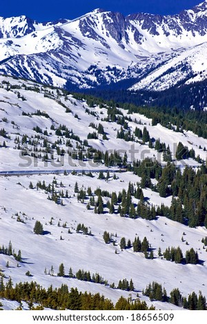 Trail Ridge Road in Rocky Mountain National Park in Colorado makes for a scenic drive along the snow covered Rockies - stock photo