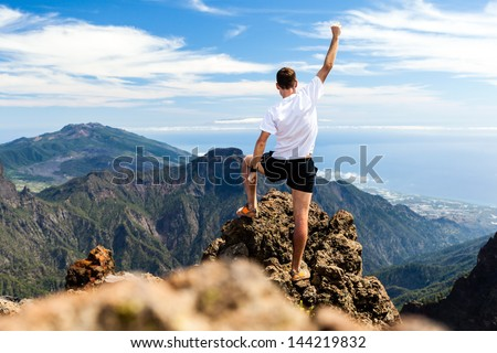 Trail runner, man and success in mountains. Running, sports, fitness and healthy lifestyle outdoors in summer nature - stock photo