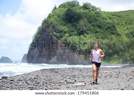 Trail running athlete man training for fitness and marathon living healthy lifestyle outside in beautiful landscape on Big Island, Hawaii, USA. Fit male sports runner model. - stock photo