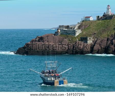 Trailer and lighthouse St John's Newfoundland - stock photo