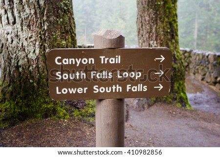 Trailhead sign showing multiple trails that make up the Trail of Ten Falls at Silver Falls State Park in Oregon. - stock photo