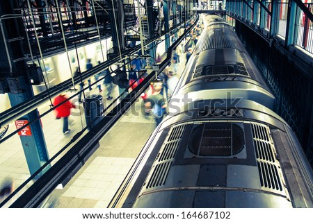 Train and commuters in New York City subway with motion blur - stock photo