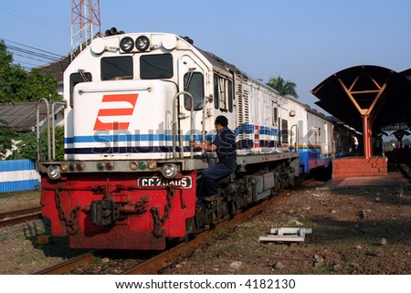 Train and railway station in Java, Indonesia - stock photo