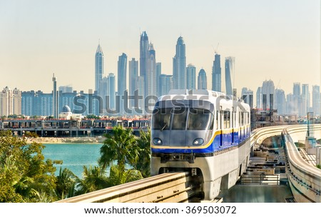 Train arriving at Atlantis Monorail station in Dubai - stock photo