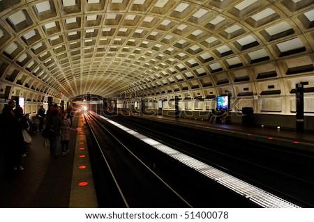 Train arriving at Metro station, Washington, DC - stock photo