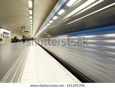 Train arriving to subway station platform - stock photo