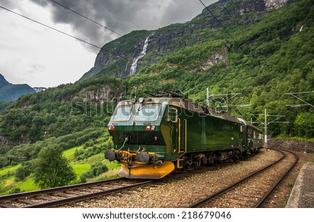 Train at famous Flam railway (Flåmsbana) line in Flam valley in Norway - stock photo