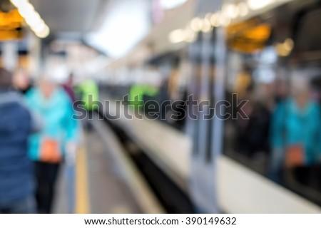 Train At Platform & People. Soft Focus Blur. Railway Station Background. - stock photo