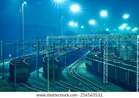 Train boxcars late at night at freight junction in Zagreb, Croatia - stock photo