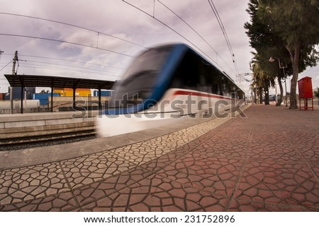 Train coming. Izmir Turkey November 19 2014. At Izmir Halkapinar izban station.izban is izmir banliyo, izmir commuter. Cumaovasi is flow direction of the train. - stock photo