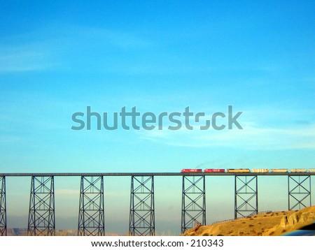 train crossing bridge - stock photo