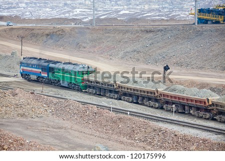 Train delivering the ore from the opencast mining site - stock photo