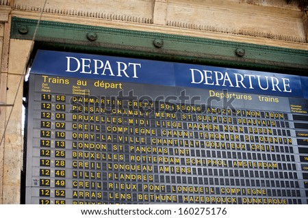Train departure schedule at the Gare du Nord train station in Paris, France