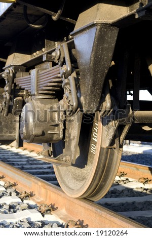 Train - detail of wag wheels - vertical composition